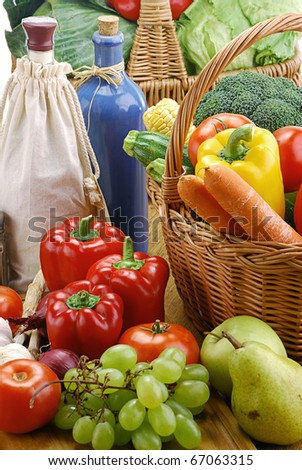 Composition with vegetables, basket and dishes on kitchen table - stock photo
