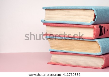Composition with vintage old hardback books, diary, fanned pages on light background. Books stacking. Back to school. Copy Space. Education background. - stock photo