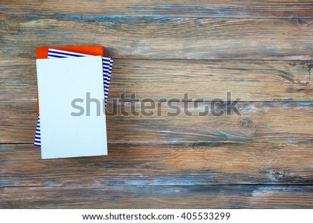 Composition with vintage old hardback books, diary on wooden deck table and red background. Books stacking. Back to school. Copy Space. Top view education background. - stock photo