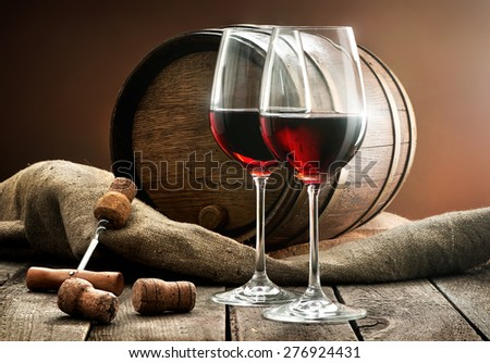 Composition with wine and cask on a wooden table - stock photo