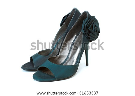 Composition with woman dark blue shoes with rose isolated on the white background