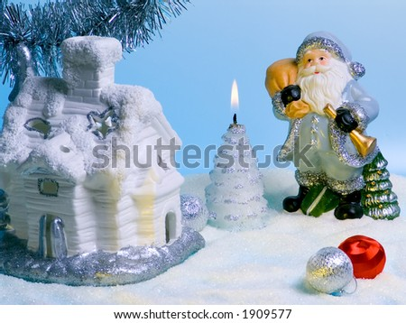 Compositions with Santa Claus, fabulous house and candle. - stock photo