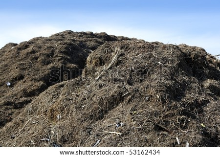 Compost big mountain outdoor ecological recycle industry environment fertilizer - stock photo