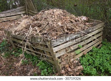 Compost heap in a wooden box - stock photo