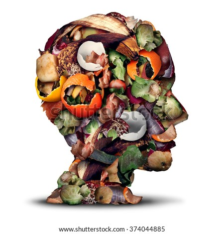 Compost thinking and composting concept as a pile of rotting kitchen fruits egg shells and vegetable food scraps shaped as a human head for recycling as an environmentally responsible icon. - stock photo