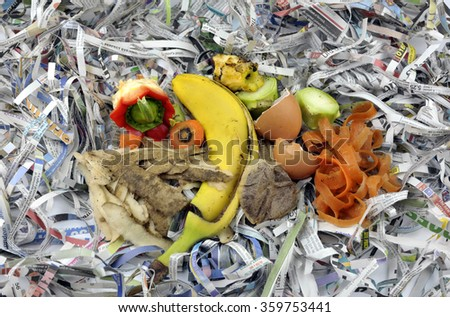 Composting materials comprising fruit and vegetable kitchen food waste with shredded newspaper. - stock photo