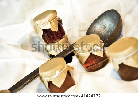compote bottles with a rustic spoon - stock photo