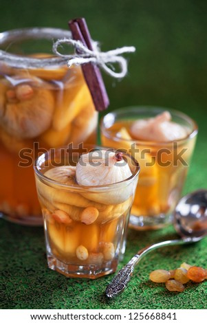 Compote of dried figs, raisins and apples with cinnamon, selective focus - stock photo
