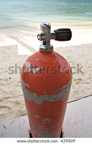 Compressed air tank for scuba diving, waiting to be used by a diver - stock photo