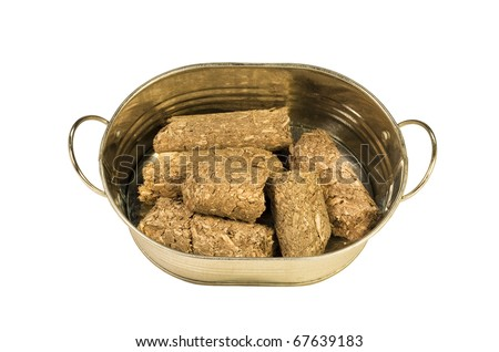 compressed bio-fuel wood pellets in a small metal bucket - stock photo