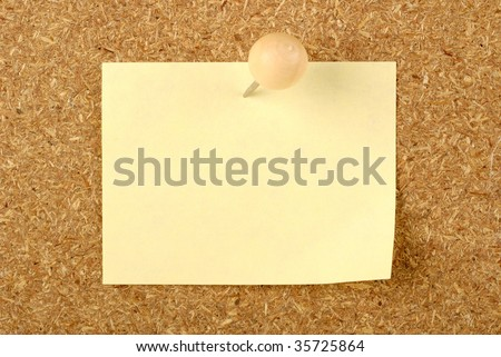 compressed board background with a note pad and push pin