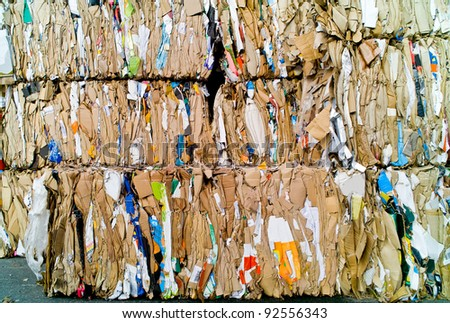 compressed paper and cardboard waiting recycling - stock photo