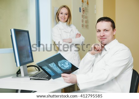 computed tomography or MRI scanner test analysis workers - stock photo