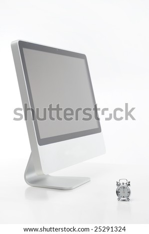 computer and alarm clock against white background