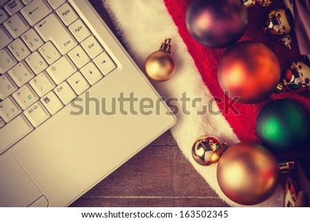 Computer and christmas gifts - stock photo