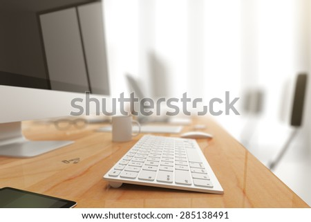Computer and keyboard on a office table, shallow depth of field - stock photo