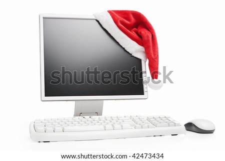 Computer and Santa hat with blank screen to be inserted with image