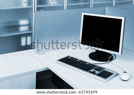 computer behind the glass in a modern office - stock photo
