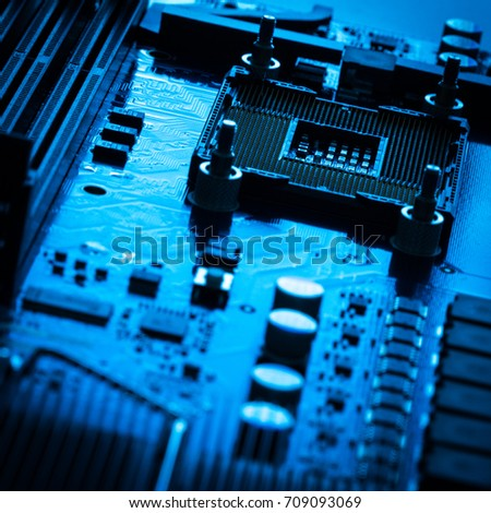 Computer board chip circuit cpu core blue technology background or texture with processors microelectronics hardware concept electronic device motherboard