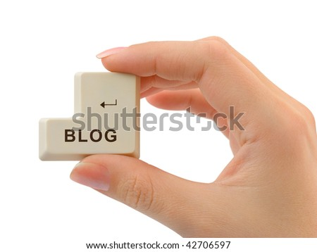 Computer button Blog in hand isolated on white background
