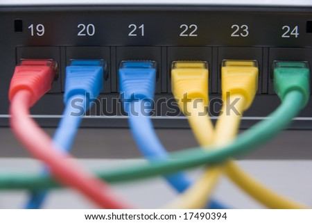 Computer Cables Connected To A Router - stock photo