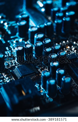 computer capacitors on the motherboard  blue background - stock photo