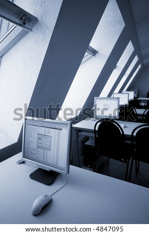computer class with blue tint - stock photo