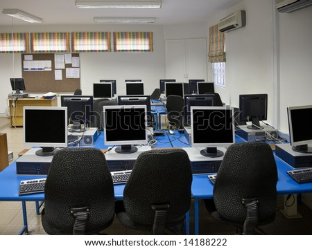 Computer classroom with plenty desktops and TFT screens - stock photo