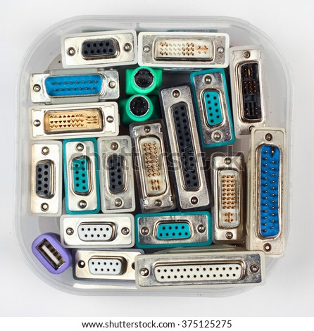 Computer connectors and adapters in plastic jar