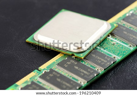 Computer CPU  and RAM module isolated on black background. - stock photo