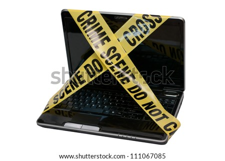 "Computer Crime Scene - A laptop computer is wrapped in yellow police tape reading ""Crime Scene Do Not Cross"". The concept represents compromised computer systems and poor network security. - stock photo"