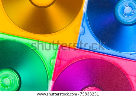 Computer disks in multiciolored boxes - technology background - stock photo