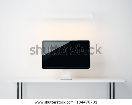 computer display on a white table