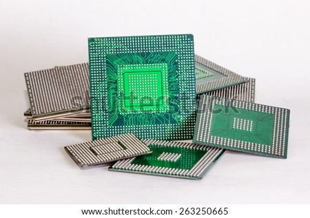 Computer electronic chips isolated on white arranged in a stack. The chips are placed upside down or facing the viewer. there are different chips in the stack - stock photo