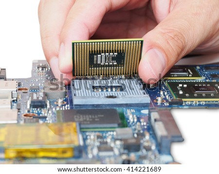 Computer engineer is installing into mainboard - stock photo
