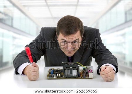 Computer engineer working in a motherboard at the office