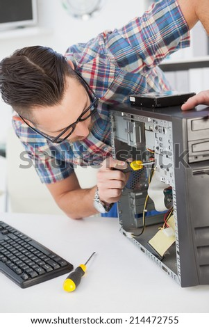 Computer engineer working on broken console in his office - stock photo