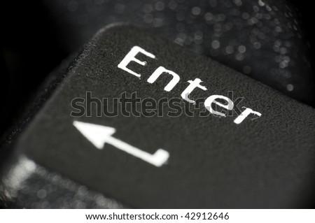 Computer enter key macro with shallow DOF - stock photo