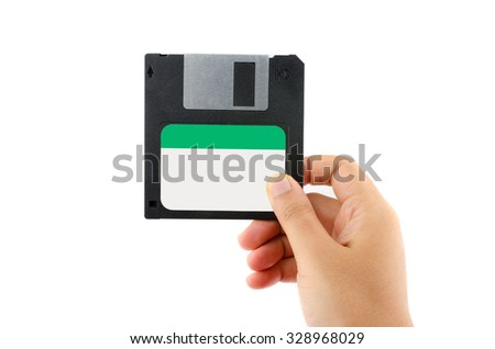 Computer floppy disk  in Female Hand isolated on white background. - stock photo