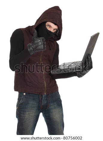 computer hacker - criminal in balaclava with the laptop, thumb up - stock photo