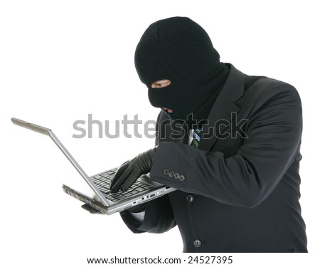 Computer hacker - criminal with the laptop computer - stock photo