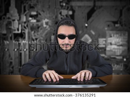 Computer Hacker With Digital Background - stock photo