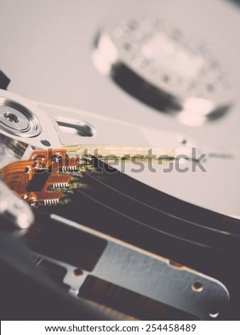 computer hard disk drive close-up shot. shallow depth of field. macro - retro vintage effect - stock photo