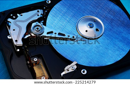 computer hard disk storage device with binary digits - stock photo