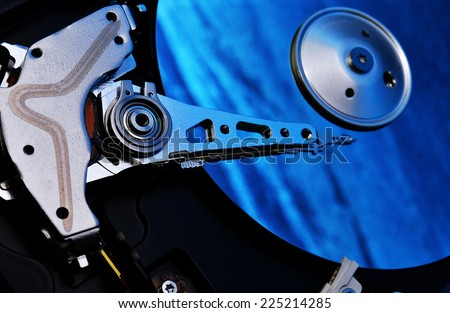 computer hard disk storage device with blue reflection - stock photo