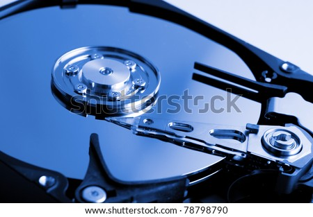 Computer hard drive in blue tone - stock photo