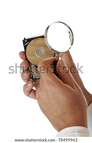 Computer harddisk is checked for failure with magnifying glass. Isolated on white background.