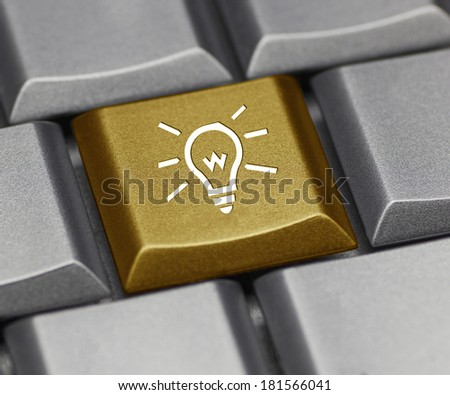 Computer key gold - light bulb - stock photo