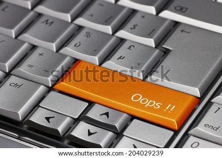 Computer key orange - Oops! - stock photo