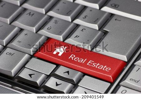 Computer key - Real Estate with house icon - stock photo